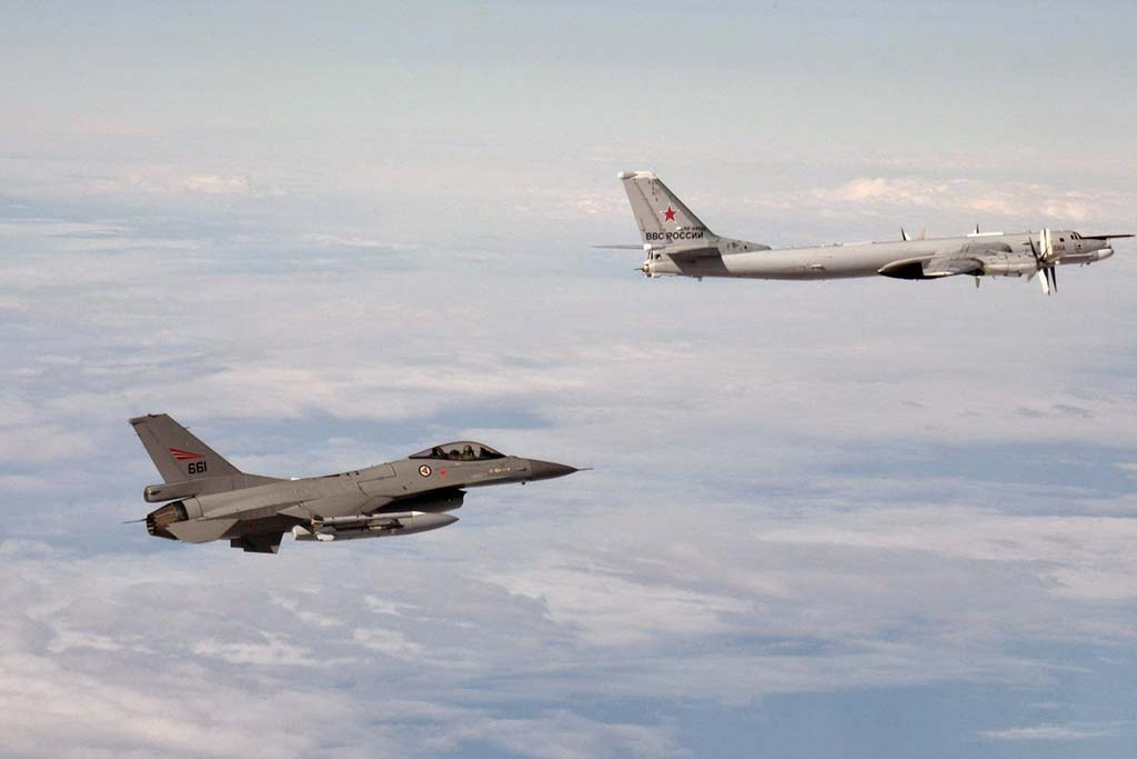 NATO F-16 Fighter Falcon with Russian Tupolev Tu-95 Bear-H
