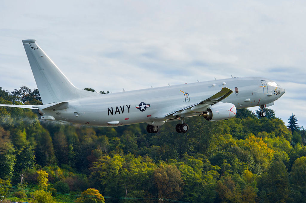 US Navy Boeing delivered the 18th P-8A Poseidon aircraft to the U.S. Navy ahead of schedule October 14, where it joined other Poseidon aircraft being used to train Navy crews. The P-8A departed Boeing Field in Seattle for Naval Air Station Jacksonville, Fla., and was Boeing's fifth delivery this year.(Photo by Boeing /SEATTLE, Oct. 15, 2014)