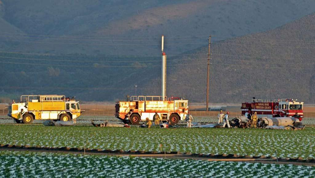 Ventura County and Navy firefighters examine the scene where a military jet crashed into a field near Naval Station Ventura County near Port Hueneme, Calif., killing the pilot, Wednesday, Oct. 29, 2014. / AP Photo/FLMedia, Johnny Corona