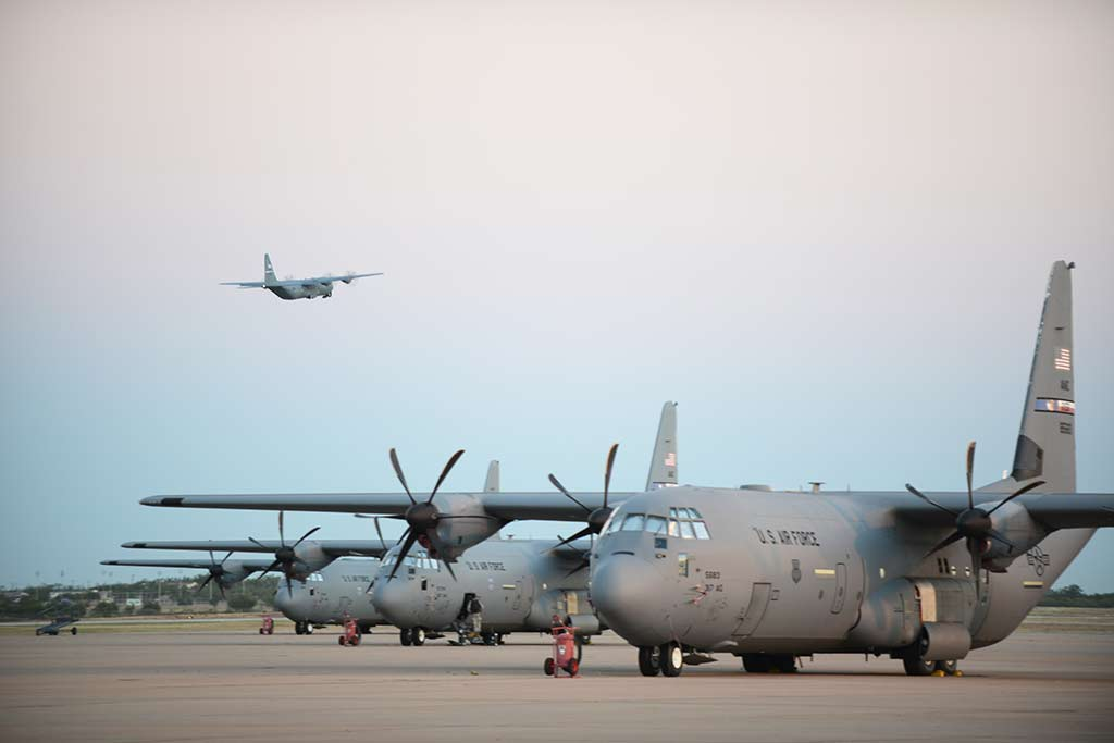 A USAF C-130J Super Hercules departs from Dyess Air Force Base, Texas, Oct. 29, 2014. More than 35 Airmen and two C-130Js from the 317th Airlift Group and 7th Bomb Wing deployed to an air base in Western Europe, where they will provide tactical airlift support for Operation United Assistance. (U.S. Air Force photo by Airman 1st Class Kedesha Pennant)
