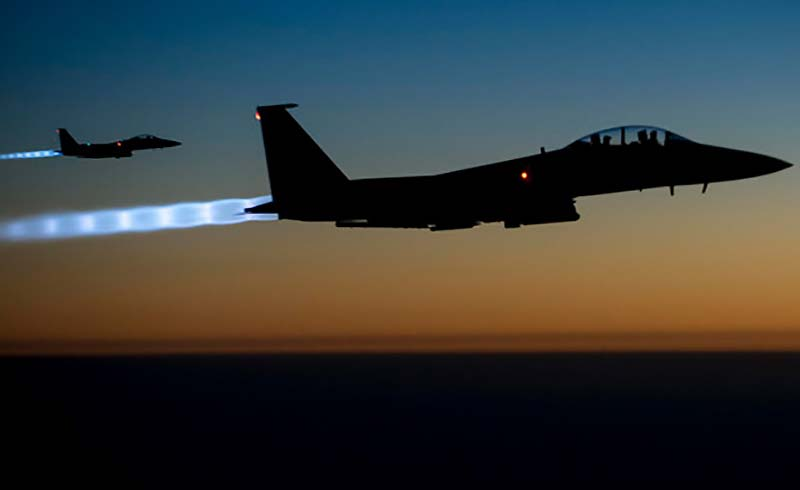 A pair of U.S. Air Force F-15E Strike Eagles fly over northern Iraq after conducting airstrikes in Syria, in this U.S. Air Force handout photo taken early in the morning of September 23, 2014. (Photo by Reuters)