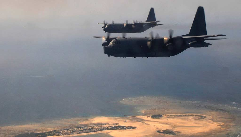 Two USAF MC-130P Combat Shadows fly over the coast of Okinawa, Japan. (Photo by US Air Force photo / airman 1st class Keith James.)