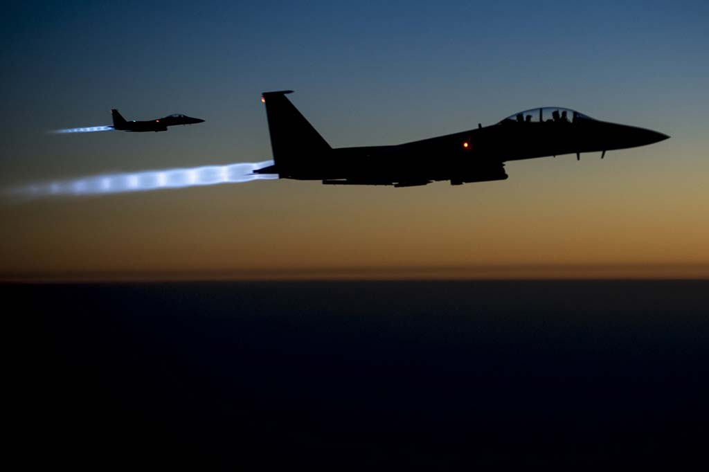 A pair of U.S. F-15E Strike Eagle fighters fly over northern Iraq after conducting airstrikes in Syria in a September 2014 photo released by the U.S. Air Force. (Associated Press)