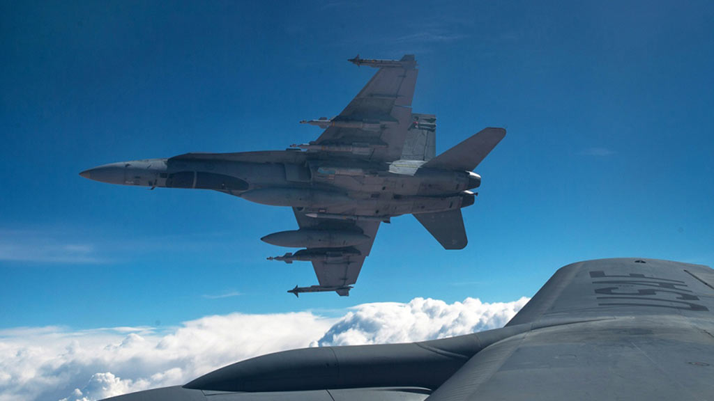 Royal Canadian Air Force CF-18 Hornets break away after refueling with a KC-135 Stratotanker assigned to the 340th Expeditionary Air Refueling Squadron, Thursday, Oct. 30, 2014 over Iraq. (Staff Sgt. Perry Aston/The Canadian Press)