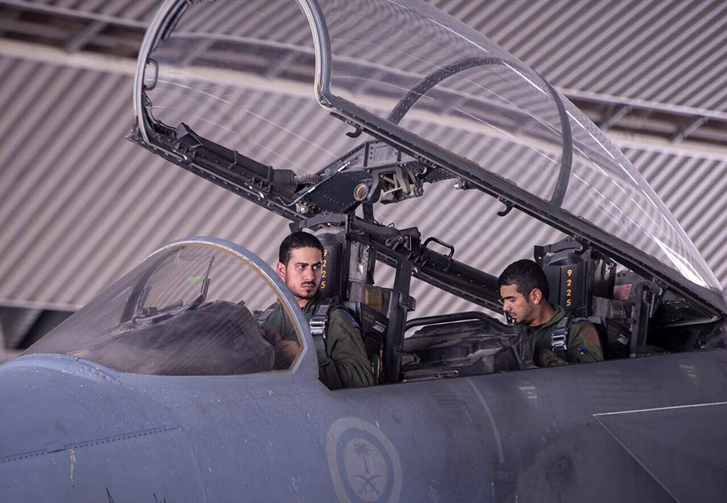 Royal Saudi Air Force pilots sit in the cockpit of a F-15 fighter jet in September as part of U.S.-led coalition airstrikes on Islamic State militants and other targets. Iran is sending ships close to Yemen in response to the airstrikes. (Photo by AP)