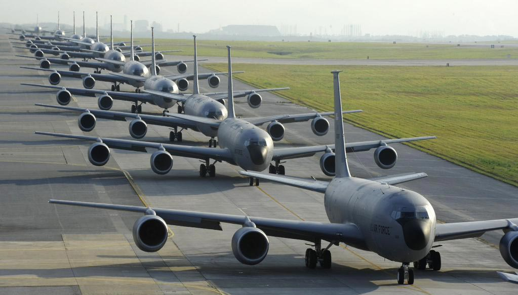 Twelve Air Force KC-135 Stratotankers from the 909th Air Refueling Squadron taxi onto the runway during Exercise Forceful Tiger on Kadena Air Base, Japan, April 1, 2015. During the aerial exercise, the Stratotankers delivered 800,000 pounds of fuel to about 50 aircraft. (Staff Sgt. Marcus Morris/U.S. Air Force)