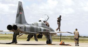 Kenya Air Force troops attend to an F-5E Tiger II fighter jet
