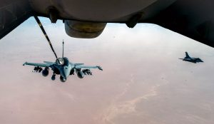A French Naval Rafale receives fuel from a 908th Expeditionary Air Refueling Squadron KC-10