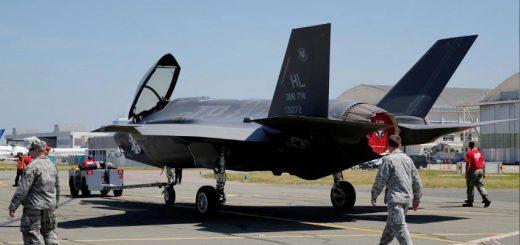 U.S. Air Force airmen walk next to a Lockheed Martin F-35 Lightning II aircraft